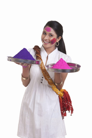 Portrait of a WOMEN with holi colours Stock Photo