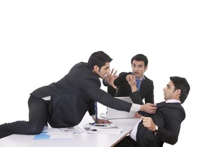 intervening: Businessman getting violent with fellow businessman Stock Photo
