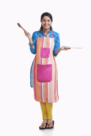 Portrait of a young WOMEN wearing an apron