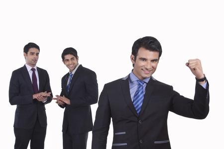 rejoices: Colleagues clap as fellow businessman rejoices