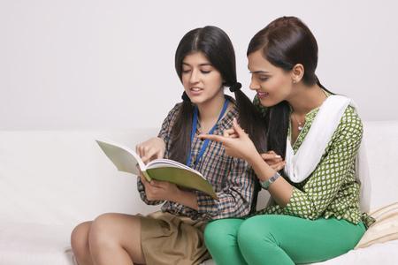 Elder sister teaching younger sister Stock Photo