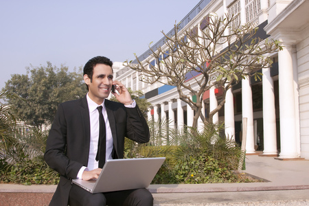 Businessman talking on a mobile phone, INDIA, DELHI