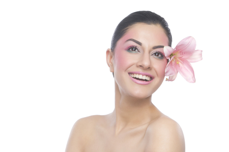 bodycare: Beautiful woman with flower smiling