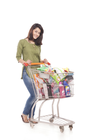 side shot: Portrait of a married woman with a shopping cart