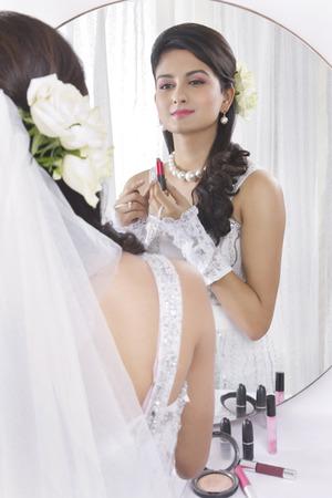 Bride wearing make up