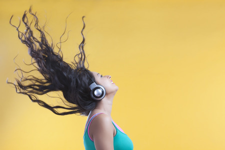 music background: Young woman listening to music