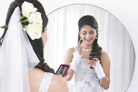 christian marriage: Bride admiring her own photograph Stock Photo