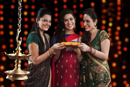 Young women celebrating Diwali Stock Photo