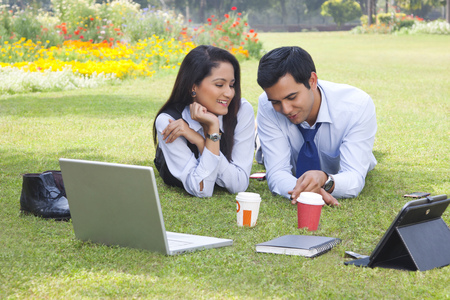 coy: Businessman and businesswoman working in a park