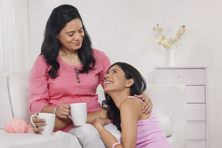 furniture: Mother and daughter having tea