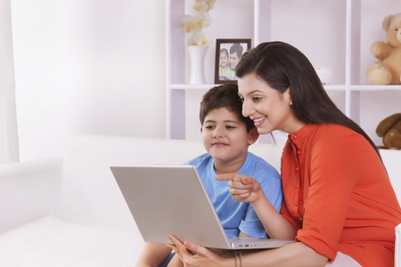 furniture: Mother and son looking at laptop