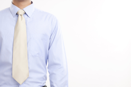 welldressed: Midsection of businessman in shirt and tie against white background Stock Photo