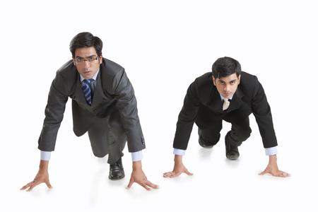 Full length of determined businessmen getting ready for race against white background Stock Photo