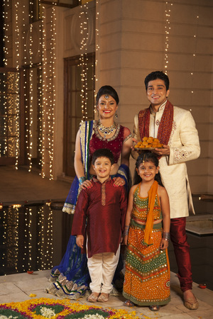 Portrait of family celebrating Diwali