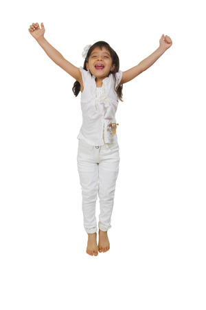 children s feet: Little girl jumping in the air
