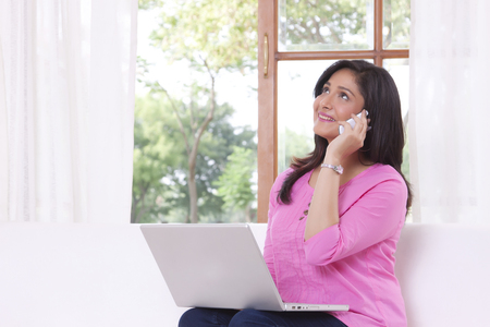 Woman talking on mobile phone Stock Photo - 80704257