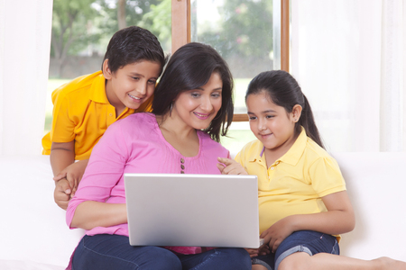 front house: Mother and kids looking at laptop