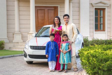 kurta: Portrait of family standing next to new car