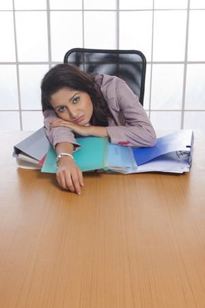 exhausting: Businesswoman tired with work pressure Stock Photo