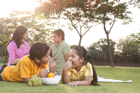 front view: Children eating fruit Stock Photo