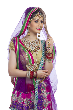 Traditional Indian bride looking away over white background
