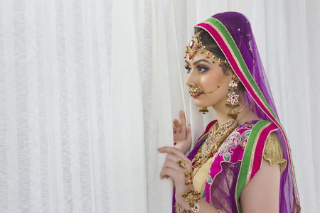 nose ring: Side view of beautiful bride by curtain at home