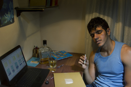 Young man with cocaine at home Stock Photo