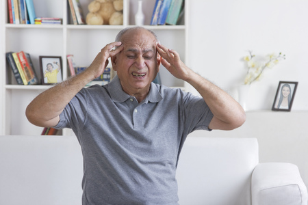 front house: Old man with headache Stock Photo