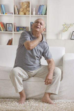 front house: Old man with pain in neck Stock Photo