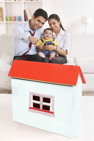 front house: Family looking at model house
