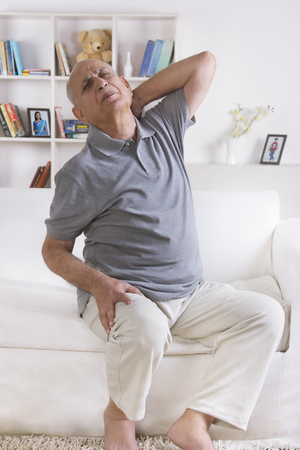 stiff: Old man with pain in neck Stock Photo