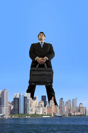 Businessman standing over the city Stock Photo