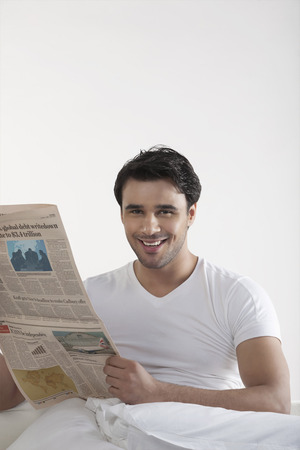 one sheet: Man holding a newspaper Stock Photo