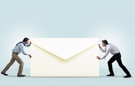 Two men with an envelope