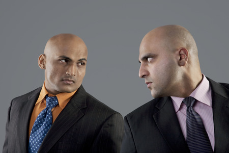 intimidating: Businessmen looking at each other Stock Photo