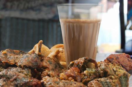 Close-up of chai with pakoras and bhajiyas