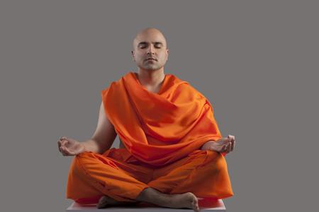 'eyes shut: Monk meditating