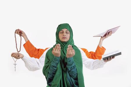 A Muslim woman praying Stock Photo