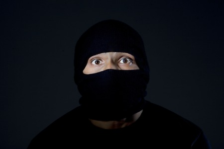 menace: Portrait of a robber