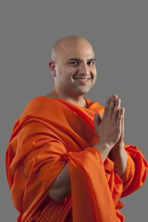 joyfulness: Portrait of a monk praying