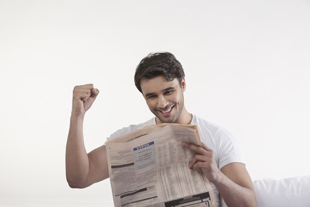 front house: Man rejoicing after reading newspaper