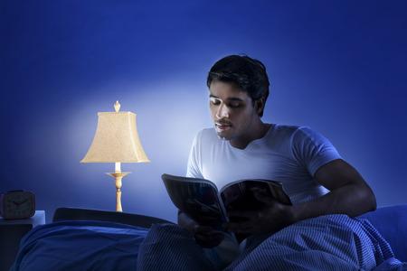 one sheet: Man reading a magazine