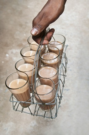 Close-up of mans hand holding tray of chai Stock Photo
