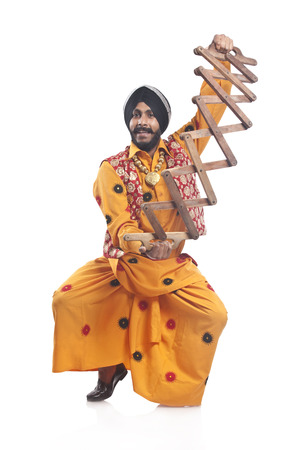 religious clothing: Portrait of Sikh man with a sappa Stock Photo