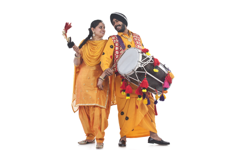 religious clothing: Sikh bhangra dancers standing back to back