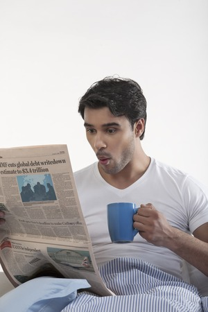 front house: Man with a newspaper and coffee