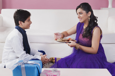 kurta: Sister doing aarti of her brother at the festival of Bhaidooj