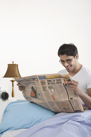 front house: Man reading a newspaper