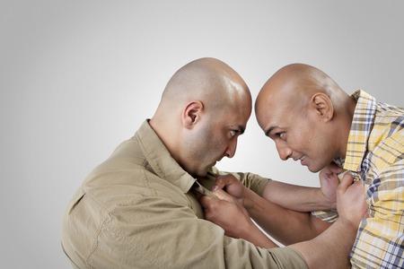 aggressiveness: Bald men fighting Stock Photo