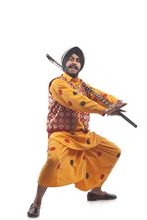 religious clothing: Portrait of Sikh man doing bhangra dance